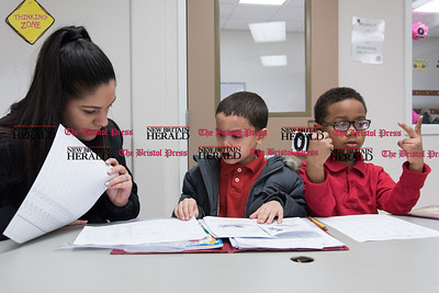 020717  Wesley Bunnell | Staff  Aliyah Gonzalez of the Boys and Girls Club of New Britain helps 6 year old Julius Gonzalez, center, with reading a story as Julian Vasquez, age 7, works on math assignments on Tuesday February 7.
