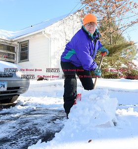 021317  Wesley Bunnell | Staff  Jeannette McAllister of New Britain shovels her driveway on Monday Feb. 13.