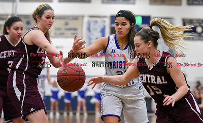 021317  Wesley Bunnell | Staff  Bristol Eastern girls basketball vs Bristol Central on Feb. 13 at Bristol Eastern High School. Miya Laprise (21), middle and Meghan Hamel (15) on the right fight for a rebound.