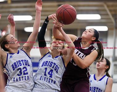 021317  Wesley Bunnell | Staff  Bristol Eastern girls basketball vs Bristol Central on Feb. 13 at Bristol Eastern High School. Jillian Lebeau (32), Diana Wnuk (14) and Sara Strilkauskas (13) fight for a rebound.