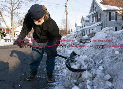 021317  Wesley Bunnell | Staff  Bob Michaud of Jacob St. in Bristol helps clear the side of the road in front of his home on Monday Feb. 13.