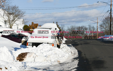 021417  Wesley Bunnell | Staff  A car and flat bed tow truck are covered in snow on the side of Pinehurst Ave in New Britain on Monday Feb. 13.