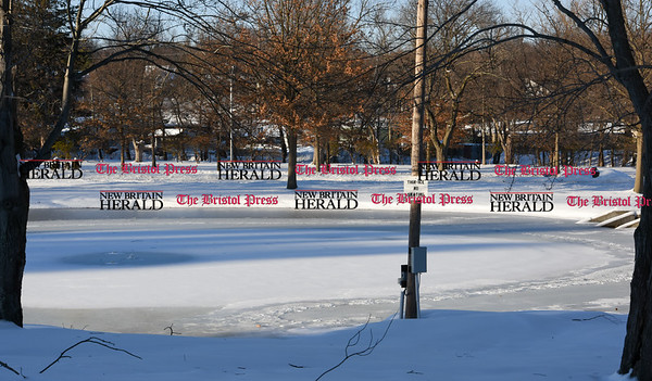 021317  Wesley Bunnell | Staff  A pond on Memorial Blvd Park in Bristol with a thin ice no skating sign on Monday Feb. 13.