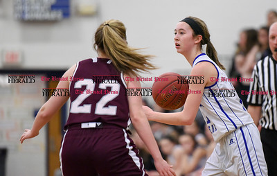 021317  Wesley Bunnell | Staff  Bristol Eastern girls basketball vs Bristol Central on Feb. 13 at Bristol Eastern High School. Hannah Maghini (11) with the ball and Sarah Guerin (22).