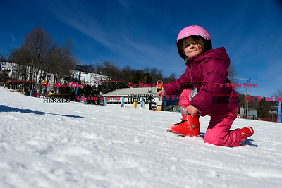 2/17/2017 Mike Orazzi | Staff Makenzie Pippa eats snow while at Mount Southington Friday.