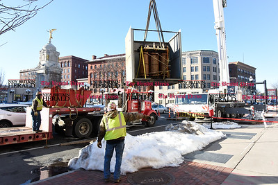 021717  Wesley Bunnell | Staff  A new 5 ton transformer was hoisted to the top of 235 Main St. by a crew from Barnhart Crane & Rigging along with Central CT Cable in New Britain on Friday afternoon. Pictured here is the old transformer which failed on Monday being removed.