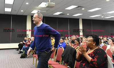 021617  Wesley Bunnell | Staff  Buzzfeed's Media Editor Craig Silverman spoke on Thursday Feb. 16 at CCSU regarding the surge of fake news in online media.  Silverman is shown walking to the podium after being introduced.