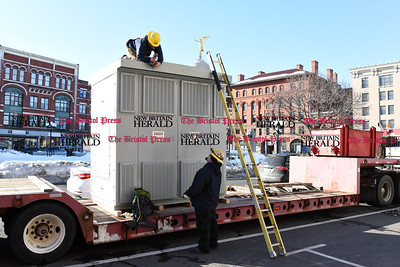 021717  Wesley Bunnell | Staff  A new 5 ton transformer was hoisted to the top of 235 Main St. by a crew from Barnhart Crane & Rigging along with Central CT Cable in New Britain on Friday afternoon. The transformer is shown being prepped for the move.