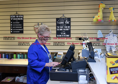021717  Wesley Bunnell | Staff  Longtime volunteer at the Hospital of Central CT Kathleen Yuskis works the cash register of the gift shop on Friday Feb 17.