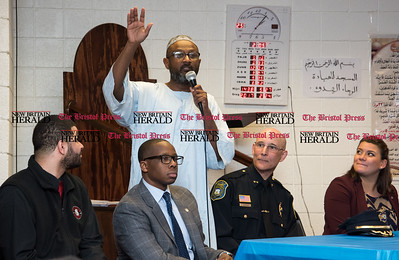 022317  Wesley Bunnell | Staff  Mayor Erin Stewart along with other city officials spoke at the Islamic Association of New Britain on Feb. 24 regarding her support for the Muslim community. President of the Executive Board for the Association , Omer Abdelgader, speaks to the crowd. From the left are Alderman Kristian Rosado, Alderman Daniel Davis, Police Chief James Wardwell and Mayor Erin Stewart.