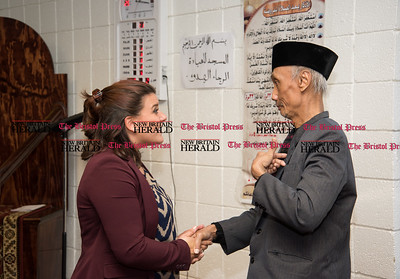 022317  Wesley Bunnell | Staff  Mayor Erin Stewart along with other city officials spoke at the Islamic Association of New Britain on Feb. 24 regarding her support for the Muslim community. Mayor Stewart speaks with resident Sugitno Sijuti regarding his concerns.