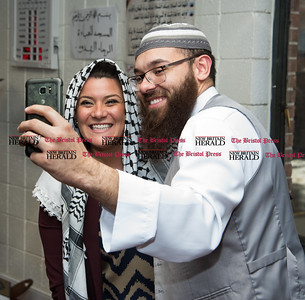022317  Wesley Bunnell | Staff  Mayor Erin Stewart along with other city officials spoke at the Islamic Association of New Britain on Feb. 24 regarding her support for the Muslim community. Mayor Stewart poses for a photo with New Britain resident Dawud Ortiz after asking to borrow his scarf.
