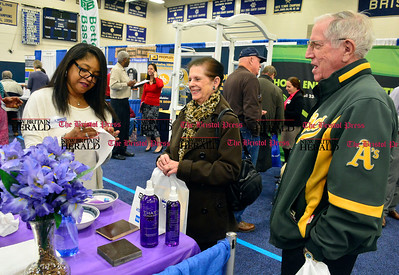 2/20/2016 Mike Orazzi | Staff Denise Scales cleans Josie Reardon's glasses as her husband John looks on during the Home & Business Expo at Bristol Eastern High School on Saturday.