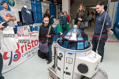 Feb. 21- The 31st annual business expo at Bristol Eastern High School. Ciera Grenier of Bristol chats with Sami the robot. (Ray Shaw Special to The Press)