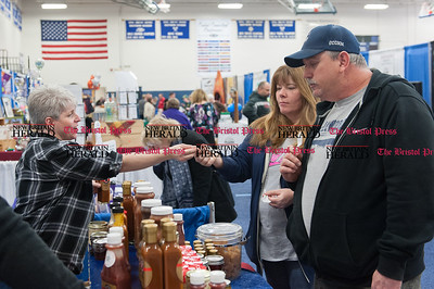 Feb. 21- The 31st annual business expo at Bristol Eastern High School. Customers Debbie and John McPhee tastesting at a vendor booth. Julie Chase is pictured far left.  (Ray Shaw Special to The Press)