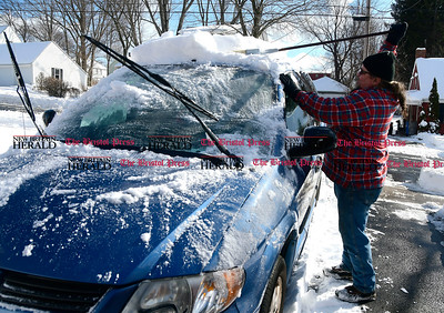 2/10/2017 Mike Orazzi | Staff David Boucher cleans off his vehicle while cleaning up from Thursday's snowstorm on Friday in Bristol.