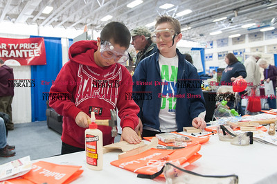 Feb. 21- The 31st annual business expo at Bristol Eastern High School. Tyler Chaivanik (12) and Noah Bernier (12) learning building skills at a Home Depot vendor station. (Ray Shaw Special to The Press)