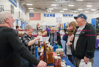 Feb. 21- The 31st annual business expo at Bristol Eastern High School. Business owners Richard Letourneau and Julie Chase give samples to Julie and John McPhee. (Ray Shaw Special to The Press)
