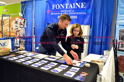 2/20/2016 Mike Orazzi | Staff Bill Fontaine and his daughter Emily during the Home & Business Expo at Bristol Eastern High School on Saturday.