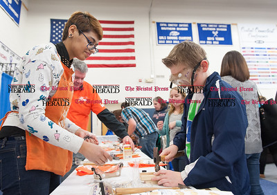 Feb. 21- The 31st annual business expo at Bristol Eastern High School. Home Depot's Mahrang Danish teaching life learning building skills to Noah Bernier (12) of Bristol. (Ray Shaw Special to The Press)