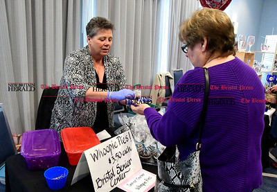 2/11/2017 Mike Orazzi | Staff The Bristol Senior Center's Debbie Parent gives a sample of Whoopie Pie to Nancy Levasseur during The 5th Annual The Bristol Chocolate Expo & Craft Show held at the Doubletree Hilton in Bristol Saturday.