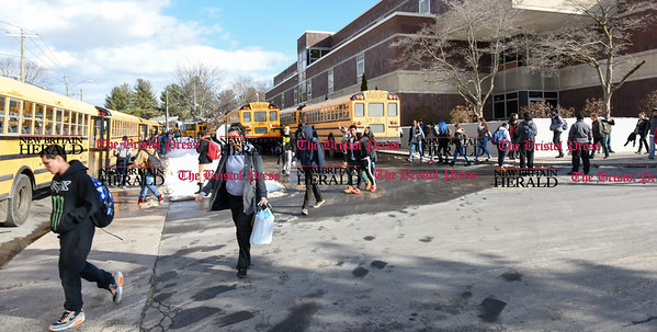 020117 Wesley Bunnell | Staff  Students exit New Britain High School at the end of school day on Wednesday and prepare to board buses for their ride home.