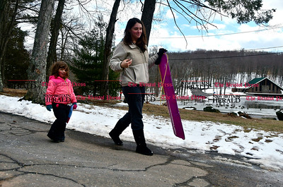 2/1/2017 Mike Orazzi | Staff Kim Martini and her daughter Lily after spending some time sledding in Bristol's Page Park Wednesday afternoon.