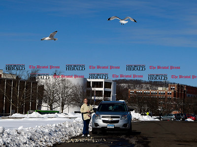 2/14/2017 Mike Orazzi | Staff Susan Paris while feeding seagulls in Centre Square in downtown Bristol Tuesday.