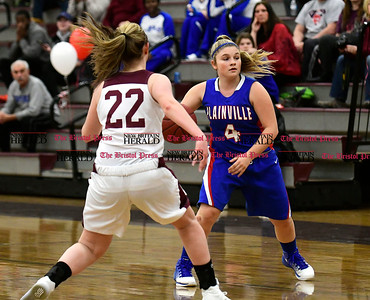 2/15/2017 Mike Orazzi | Staff Bristol Central's Sarah Guerin (22) and Plainville's Jes Masco (4) in Bristol Wednesday night.