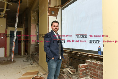 021517  Wesley Bunnell | Staff  Vincent Placeres stands amongst the construction in his soon to open restaurant at the corner of Main & West Main St. in New Britain. Mofongo Restaurant Is due to open in March.