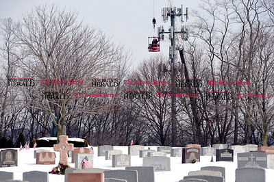 2/15/2017 Mike Orazzi | Staff Work being done on the communications town as seen from the St. Joseph Cemetery Wednesday.