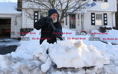 021317  Wesley Bunnell | Staff  Bob Michaud of Jacob St. in Bristol clears a large snow pile in front of his home on Monday Feb. 13.