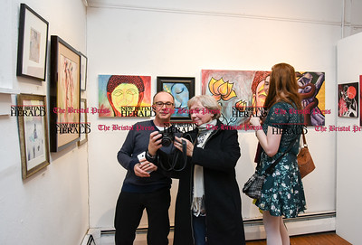 021717  Wesley Bunnell | Staff  Artist Zbigniew , left, looks over his photo taken next to an artwork of his titled Harlequins Dream with the photographer Stasia Rodriguez.  The Art League of New Britain's held a showing on Friday Feb 17 titled Love is All Around.