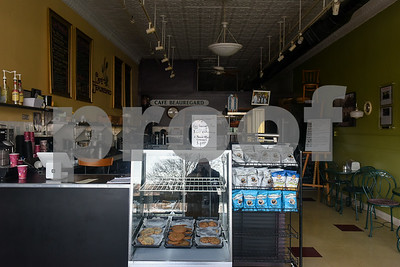 022117  Wesley Bunnell | Staff  Baked goods still sit inside a display case inside the now closed Cafe Beauregard. The cafe announced its closing with a letter taped to the door from the owner and staff.