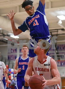 022117  Wesley Bunnell | Staff  Berlin boys basketball vs Plainville on Tuesday Feb. 22 at Berlin High School. Jailen Lindsey (11) towers over Jack Lynch (5) as he attempts a shot.