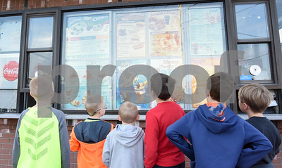 022217  Wesley Bunnell | Staff  Neighborhood children walked to Dairy Queen in Berlin on Feb. 22 for their first day of business in 2017. Staring at the menu are, from left, Landyn Nadeau, age 9, Dylan Brini, age 8, Parker Brini, age 6, Sam Monsonis, age 10, Noah Melyk, age 10 and Nathen Brini age 11.