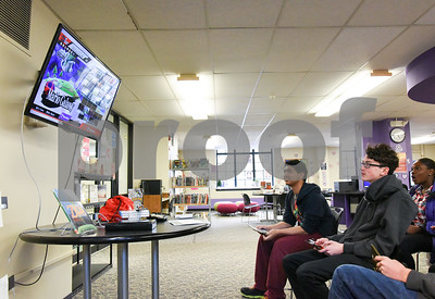 022217  Wesley Bunnell | Staff  Teens play Super Smash Brothers on the WII U inside the New Britain Public Library on Feb 22. From the left are Aman Omidwar, Alex Washburn and Chevon Phillips in the 2nd row.