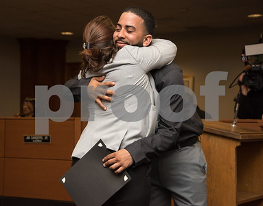 "022217  Wesley Bunnell | Staff  Juan ""Gaby"" Busanet received awards and recognition before the New Britain Common Council meeting on Feb 22. Busanet helped to rescue several residents of a burning building by climbing a ladder to the third floor of a burning building on West St. during a heavy snowstorm on Feb 9. Gaby Busanet hugs New Britain Mayor Erin Stewart after receiving an award from the city."