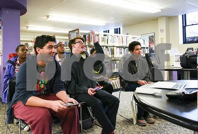 022217  Wesley Bunnell | Staff  Teens play Super Smash Brothers on the WII U inside the New Britain Public Library on Feb 22.  Aman Omidwar laughs as Alex Washburn lost in the final moments of the match. Far right is Frankie Devevo, with Chevon Phillips and Raekwon Blocker in the 2nd row.