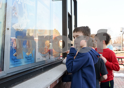 022217  Wesley Bunnell | Staff  Noah Melyk, age 10, ponders his decision at Dairy Queen on Feb. 22 in Berlin on their first day open for business in 2017.