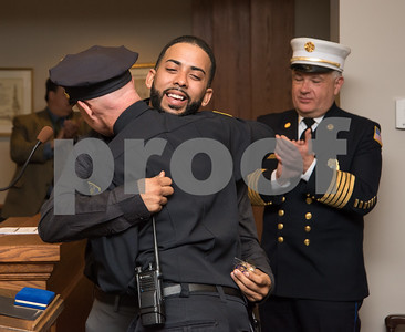 "022217  Wesley Bunnell | Staff  Juan ""Gaby"" Busanet received awards and recognition before the New Britain Common Council meeting on Feb 22. Busanet helped to rescue several residents of a burning building by climbing a ladder to the third floor of a burning building on West St. during a heavy snowstorm on Feb 9. Gaby Busanet hugs New Britain Police Chief James Wardwell after Chief Wardwell presented him with pins and challenge coins."