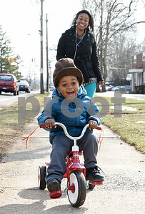 022117  Wesley Bunnell | Staff  Two year old Troymair Alvin rides his tricycle down East St. in New Britain after taking a ride with mom Amber White to grab snacks from a local convenience store.