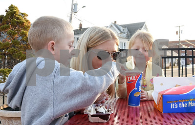 022217  Wesley Bunnell | Staff  Parker Brini, age 6, shares his ice cream with mom Amy as little sister Avery , age 4, looks on at the Dairy Queen in Berlin in Feb. 22 which was the stores first day of business for 2017.