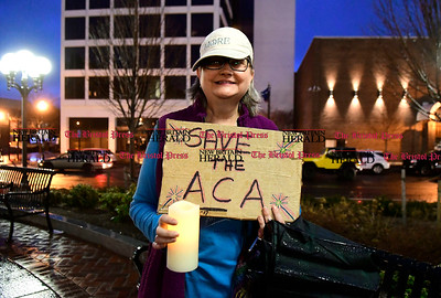 2/25/2017 Mike Orazzi   Staff Liz Bishop during a candle light vigil and rally for the Affordable Care Act (ACA) and or Obamacare, in New Britain's Central Park Saturday evening.