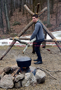 2/25/2017 Mike Orazzi   Staff Wyatt Simard demonstrates a technique for making maple syrup during the 7th Annual Maple Sugaring and Pancake Breakfast Fundraiser at Indian Rock Nature Preserve in Bristol Saturday morning.