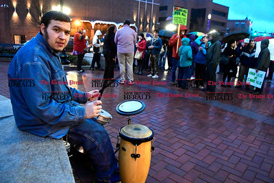 2/25/2017 Mike Orazzi   Staff Jessy Matthews bangs on his drum set during a candle light vigil and rally for the Affordable Care Act (ACA) and or Obamacare, in New Britain's Central Park Saturday evening.