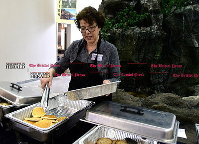 2/25/2017 Mike Orazzi   Staff Kate Houlihan serves fresh pancakes during the 7th Annual Maple Sugaring and Pancake Breakfast Fundraiser at Indian Rock Nature Preserve in Bristol Saturday morning.