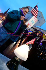 2/25/2017 Mike Orazzi   Staff Michael and Susan Kelley during a candle light vigil and rally for the Affordable Care Act (ACA) and or Obamacare, in New Britain's Central Park Saturday evening.