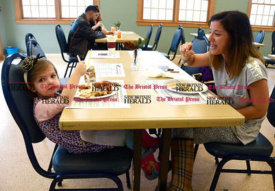 2/25/2017 Mike Orazzi   Staff Marlo McQuiggan and her daughter Kyla,3, enjoy breakfast during the 7th Annual Maple Sugaring and Pancake Breakfast Fundraiser at Indian Rock Nature Preserve in Bristol Saturday morning.