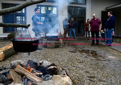 2/25/2017 Mike Orazzi   Staff Wyatt Simard (left) demonstrates a technique for making maple syrup during the 7th Annual Maple Sugaring and Pancake Breakfast Fundraiser at Indian Rock Nature Preserve in Bristol Saturday morning.